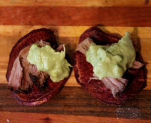 Purple Sweet Potato Chips, topped with pulled pork and creamy guacamole